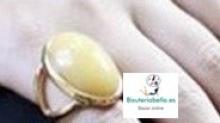 Anillo dorado con mineral redondo amarillo clarito Talla 7