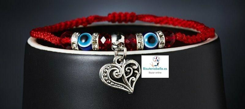 Pulsera trenzada cordon rojo,ojo turco y abalorios