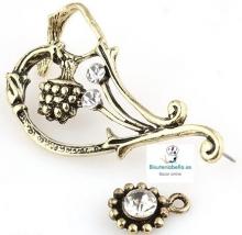Pendiente bronce ajustable a la oreja detalles florales y brillantitos