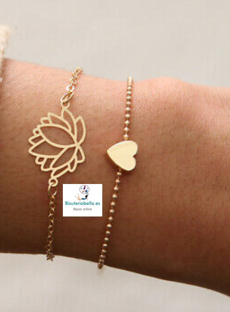 Set de pulseras doradas flor de loto y corazón