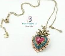 Colgante bronce corazon marino colores con brillantitos,se abre