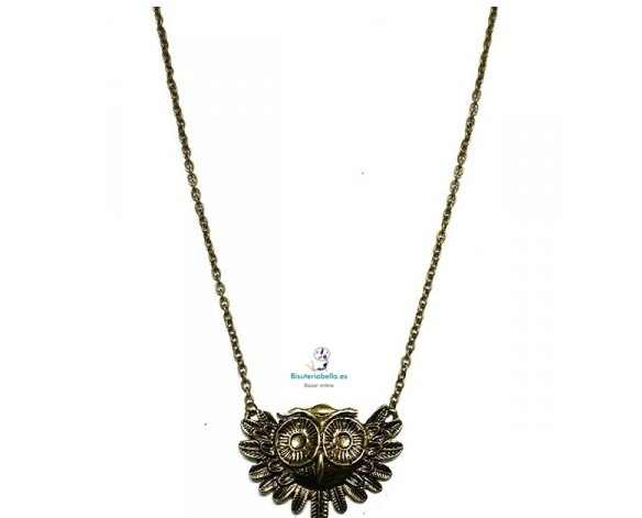 Muy original colgante en bronce en forma de buho con alas