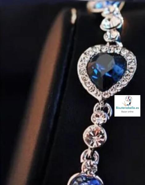 Brazalete plateado 3 corazones azules y detalles