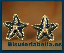 Pequeños pendientes en forma de estrellitas de mar dorados y azul marino con brillantito