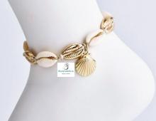 Tobillera conchas naturalesy doradas,en cordón con Detalle Mar
