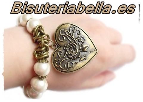 Pulsera perlas ajustable en bronce corazon grande labrado