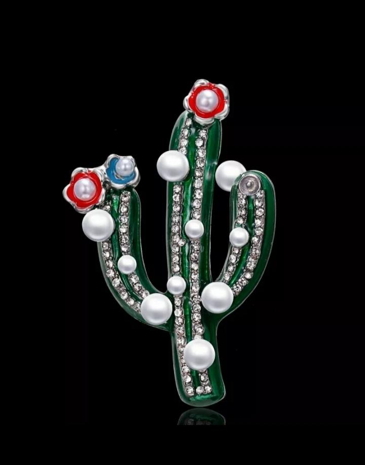 Broche plateado en forma de cactus con perlas