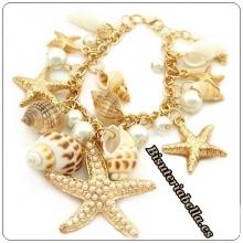Brazalete ajustable dorado caracolas,estrellas de mar detalles y perlas