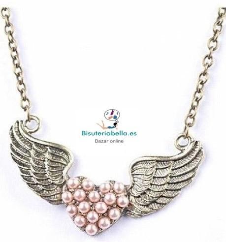 Colgante en bronce largo con perlitas rosas en forma corazon con alas