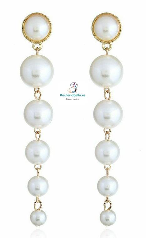 Pendientes dorados con perlas blancas  en fila grandes