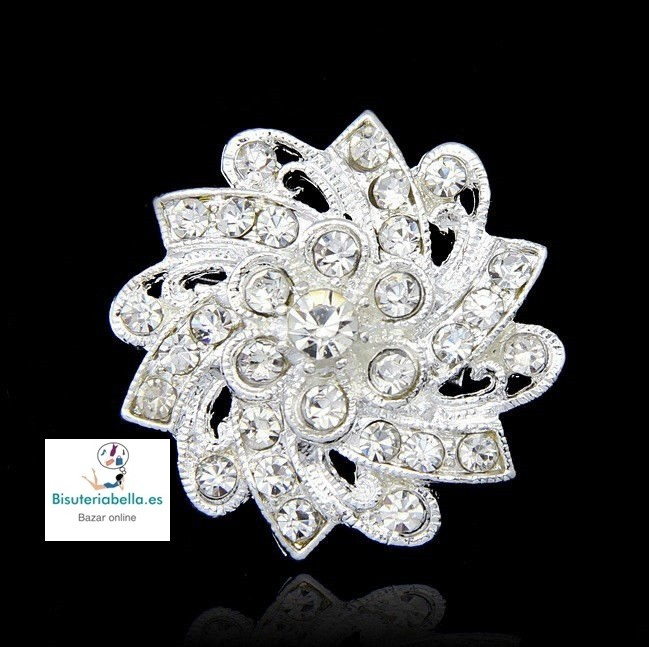 Broche Chapado plata floral en forma de espiral con brillantitos