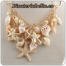 Colgante ajustable dorado caracolas,estrellas de mar detalles y perlas